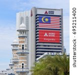Small photo of KUALA LUMPUR, MALAYSIA, AUGUST 13, 2017 : Agro Bank building with Malaysia Flag. Malaysian Independence Day celebrate on 31st August every year.