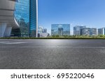 empty road with modern business ... | Shutterstock . vector #695220046