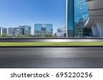 empty road with modern business ... | Shutterstock . vector #695220256