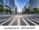 empty road with modern business ... | Shutterstock . vector #695224909