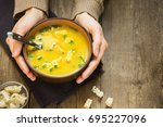 woman hands holding bowl of... | Shutterstock . vector #695227096