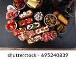 italian antipasti wine snacks...   Shutterstock . vector #695240839