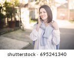 young woman smiling and... | Shutterstock . vector #695241340