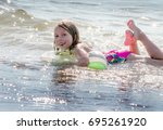 a young girl  is playing on a... | Shutterstock . vector #695261920