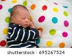 beautiful newborn baby boy ... | Shutterstock . vector #695267524