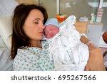 happy mom  having her baby skin ... | Shutterstock . vector #695267566