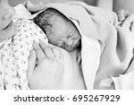happy mom  having her baby skin ... | Shutterstock . vector #695267929