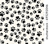 seamless animal pattern of paw... | Shutterstock .eps vector #695292046
