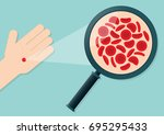 blood cells on a hand being...   Shutterstock .eps vector #695295433