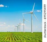 wind farm in agriculture corn... | Shutterstock . vector #695295499