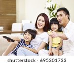happy asian family with two... | Shutterstock . vector #695301733