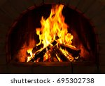 close up of burning firewood in ... | Shutterstock . vector #695302738