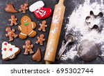 cooking christmas gingerbread... | Shutterstock . vector #695302744