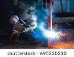 steel welding or welder... | Shutterstock . vector #695320210