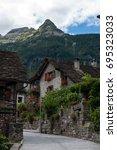 stone houses in the switzerland | Shutterstock . vector #695323033