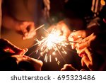 friends lit sparklers | Shutterstock . vector #695323486