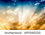 dramatic sun rays and clouds as ... | Shutterstock . vector #695340220