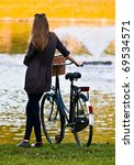 Woman with bike in park - stock photo