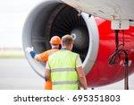 technicians in signal vests... | Shutterstock . vector #695351803