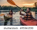 happy young couple in sea vests ... | Shutterstock . vector #695361550