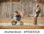 boys in the image of a rider... | Shutterstock . vector #695365318