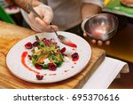 chef is adding red sauce to...   Shutterstock . vector #695370616