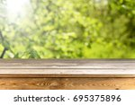 wooden table background | Shutterstock . vector #695375896