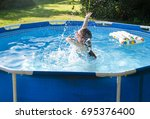 child having fun in rubber... | Shutterstock . vector #695376400