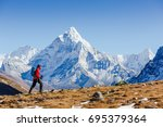 Small photo of Happy hiker walking in the mountains. Himalayas, Everest Base Camp trek, Nepal