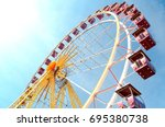 ferris wheel municipal park... | Shutterstock . vector #695380738