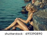 portrait of gorgeous tanned... | Shutterstock . vector #695390890