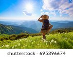 on the lawn in mountains... | Shutterstock . vector #695396674