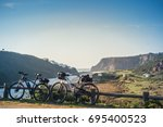 bicycle tour at odeceixe ... | Shutterstock . vector #695400523