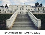 White Mansion With Grand...