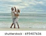 Happy Elderly  Couple  Dancing...