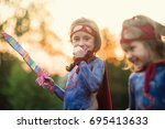 happy children play superheroes ... | Shutterstock . vector #695413633