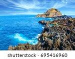picturesque black rocks and... | Shutterstock . vector #695416960