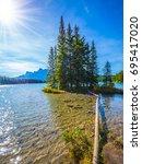 the warm morning sun warms the... | Shutterstock . vector #695417020