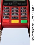 Small photo of Contact-less credit card and point of sale terminal.