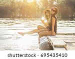 young and carefree girls. two... | Shutterstock . vector #695435410