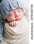 sleeping newborn baby | Shutterstock . vector #695438758