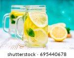 lemon water  lemonade in mugs... | Shutterstock . vector #695440678
