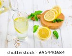 in a glass beaker  a cold... | Shutterstock . vector #695440684