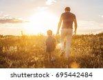 happy family enjoying walk on... | Shutterstock . vector #695442484