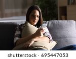 sad girl holding pillow and... | Shutterstock . vector #695447053