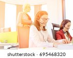 female customer service... | Shutterstock . vector #695468320