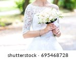 bouquet in bride's hands. bride ... | Shutterstock . vector #695468728