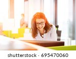 smiling young businesswoman... | Shutterstock . vector #695470060