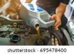 Car Mechanic Replacing And...
