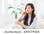 young attractive asian woman... | Shutterstock . vector #695479504